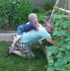 My step son riding on my back while I garden