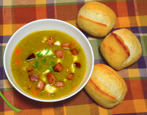 Homemade Split pea soup recipe with ham and bread rolls