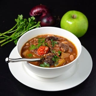 Hearty venison stew recipe in white bowl