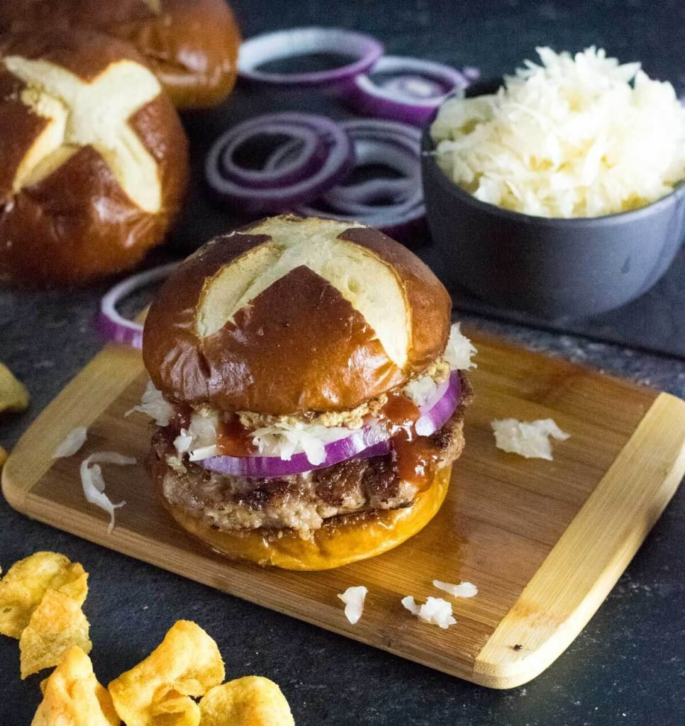 Homemade brat burger on pretzel bun