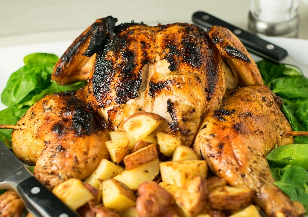 How to grill a whole chicken over charcoal