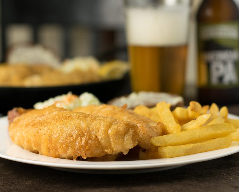 Beer battered perch recipe with french fries, coleslaw, and rye bread,
