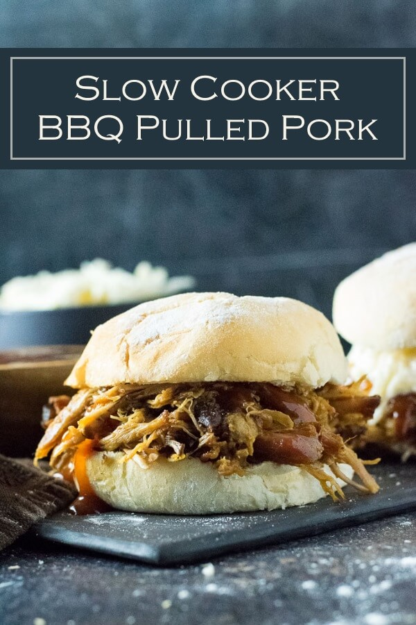 This easy Slow Cooker BBQ Pulled Pork recipe has bold barbecue flavors and is a perfect party entree. #bbq #pork
