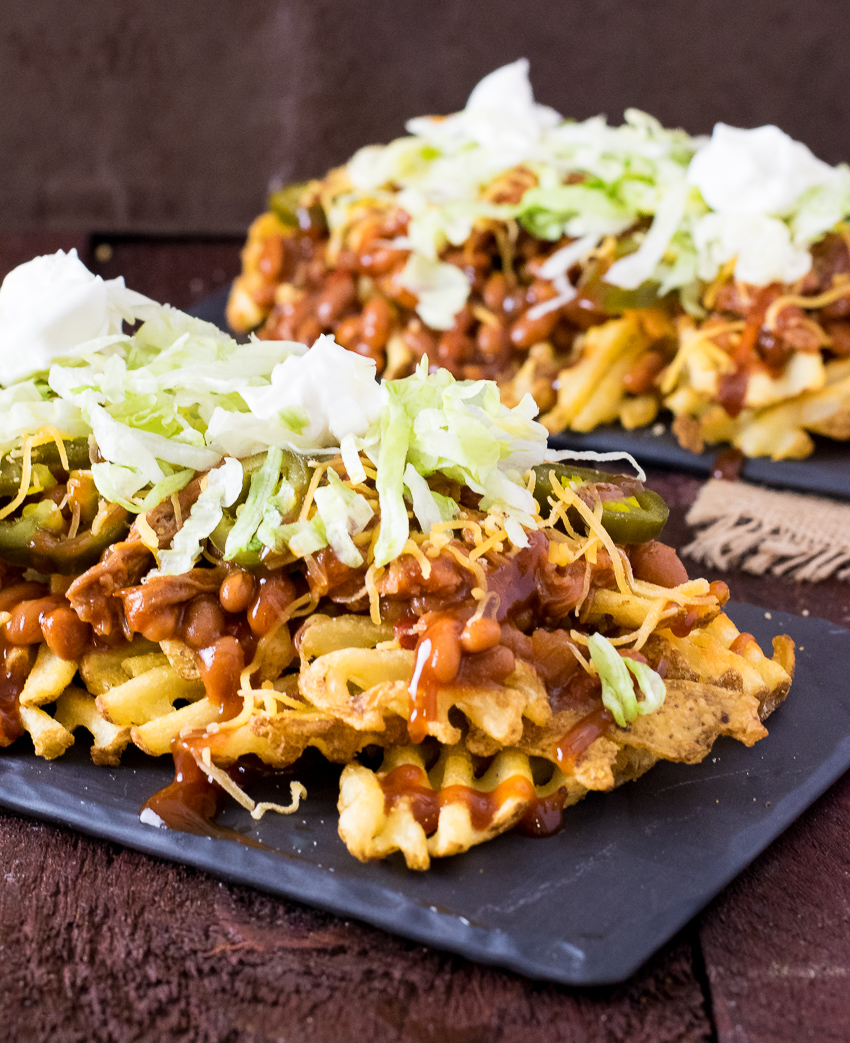 BBQ Irish Nachos piled on black tray.
