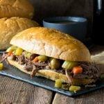 Crock Pot Italian Beef Sandwich Chicago Style on dark platter