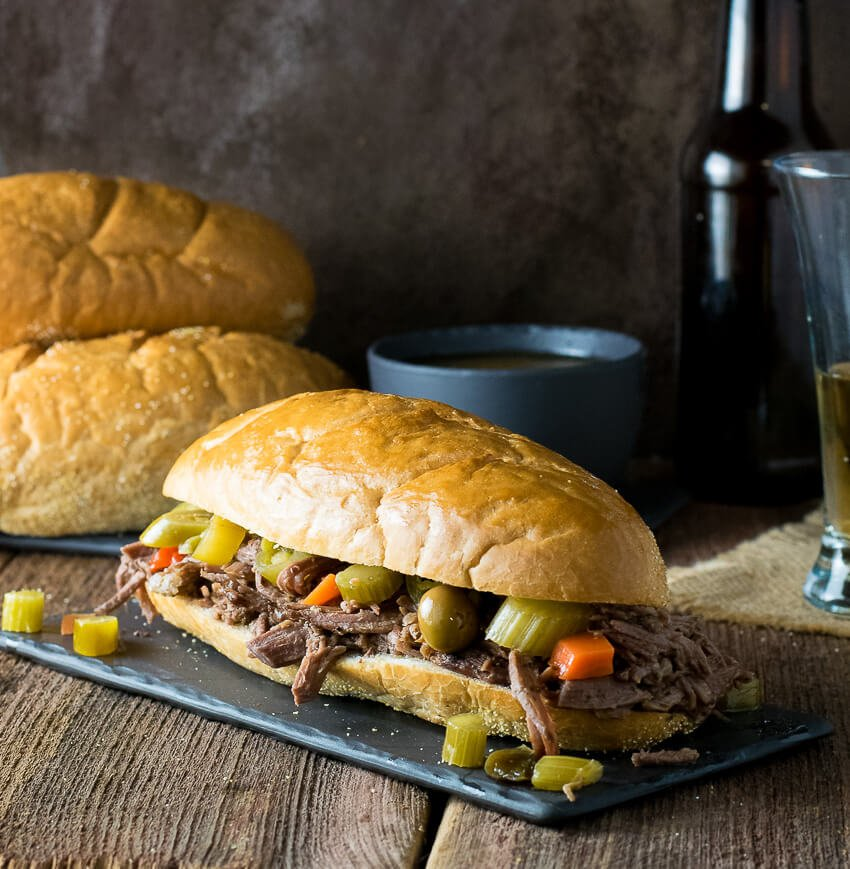 Crock Pot Italian Beef Sandwich Chicago Style on dark platter