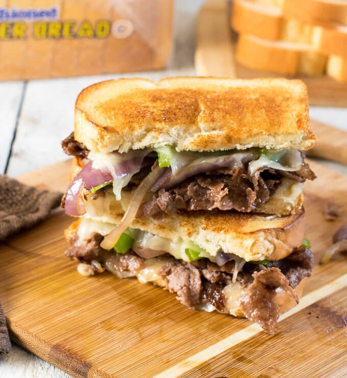 Stacked Philly Cheesesteak Grilled Cheese on cutting board
