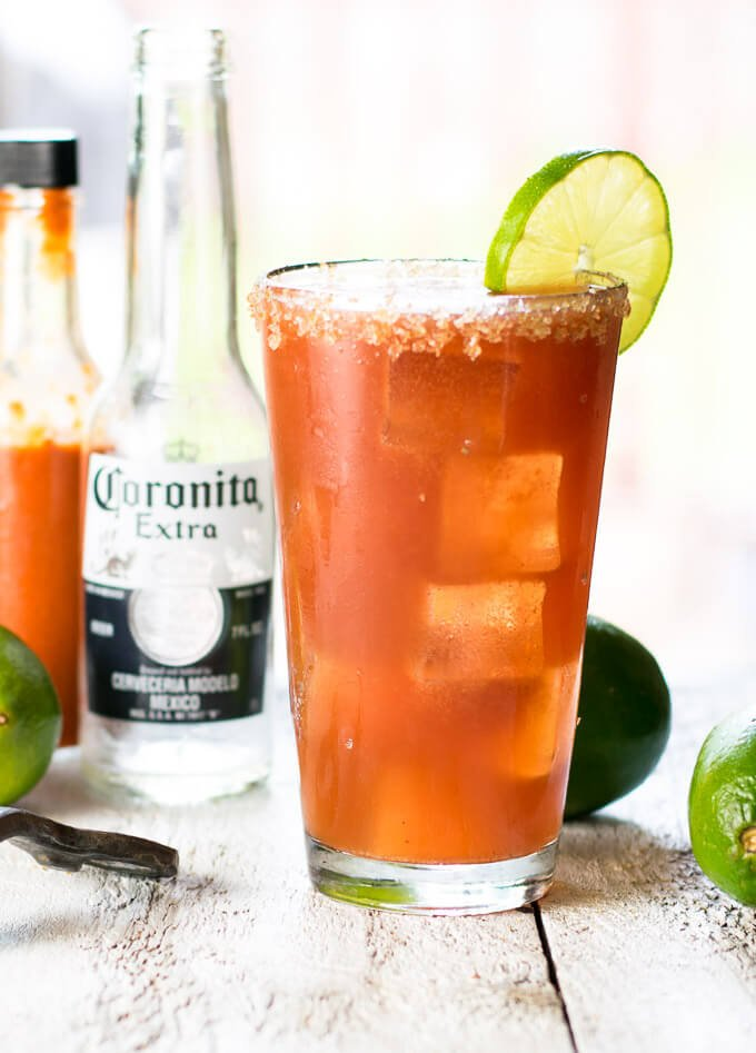 Authentic Michelada with lime garnish