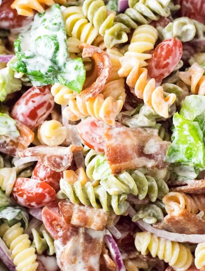 Close up look at pasta salad ingredients.