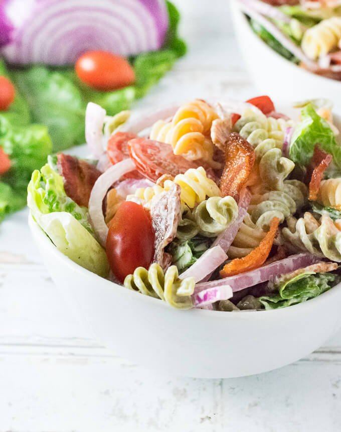 BLT Pasta Salad in a white bowl shown close up.