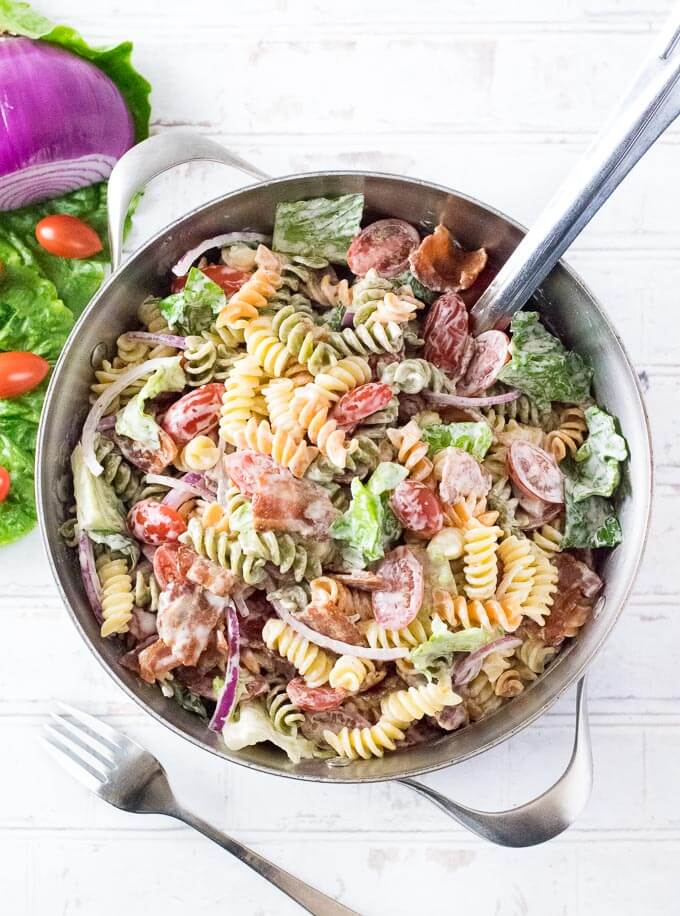 Bacon lettuce and tomato pasta salad in a pot shown from above.