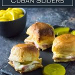 These baked Cuban sliders are painted with a sweet and savory sauce. #sliders #sandwich #cuban