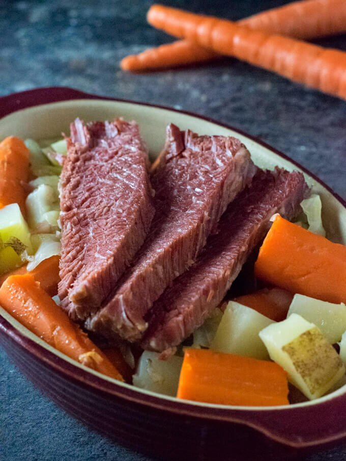 Sliced corned beef in dish with vegetables