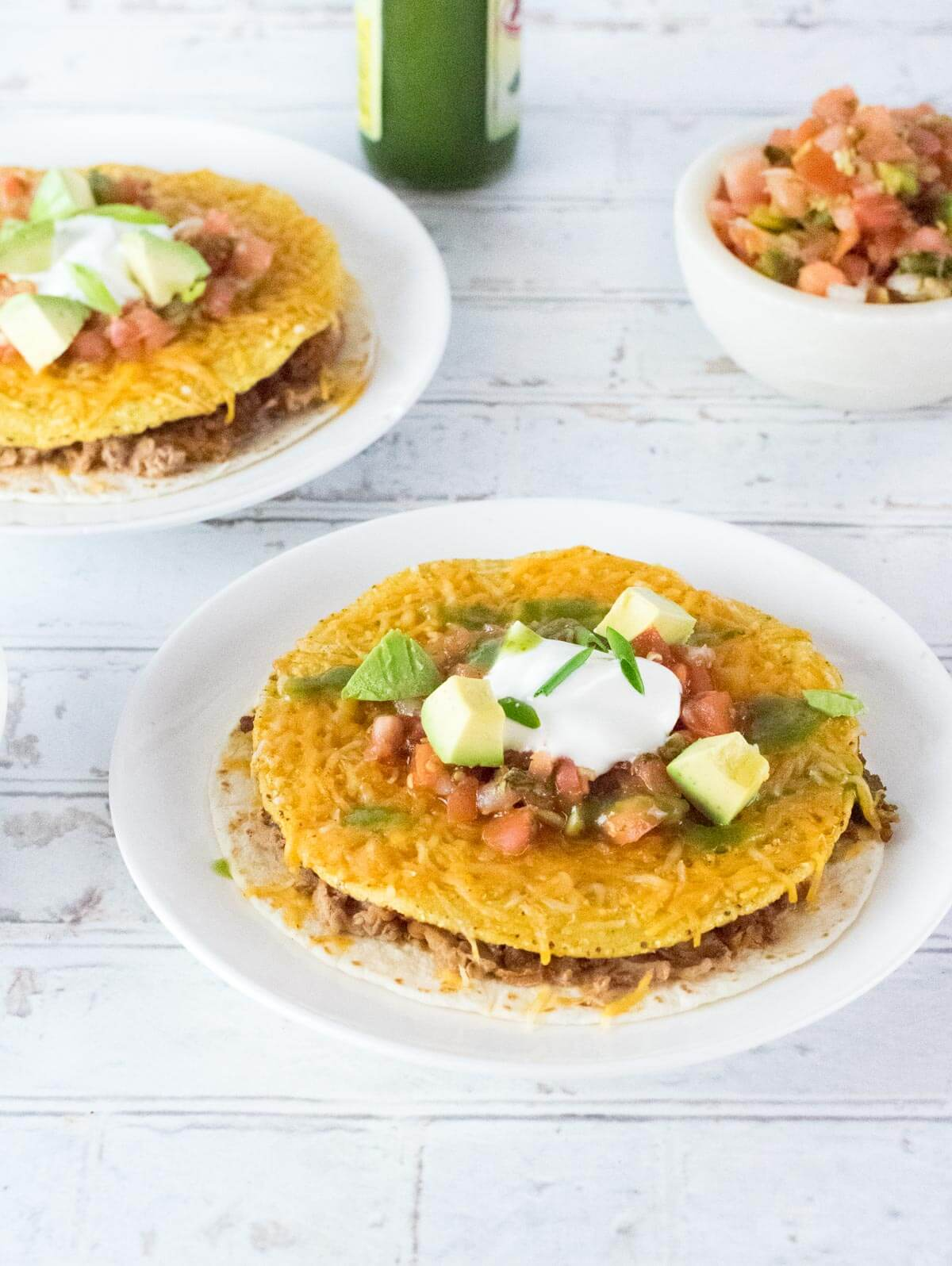 Two Taco Bell copycat Mexican pizzas on white plates.