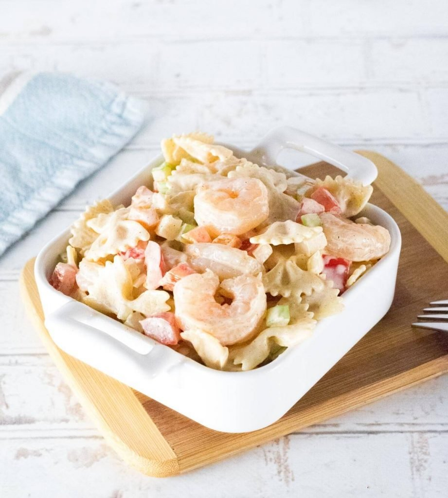 Cajun shrimp pasta salad without seasoning on top with white background.