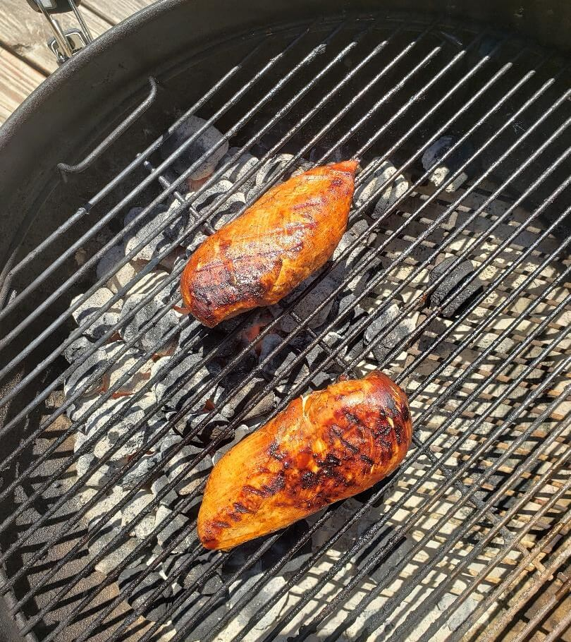 Chicken on charcoal grill