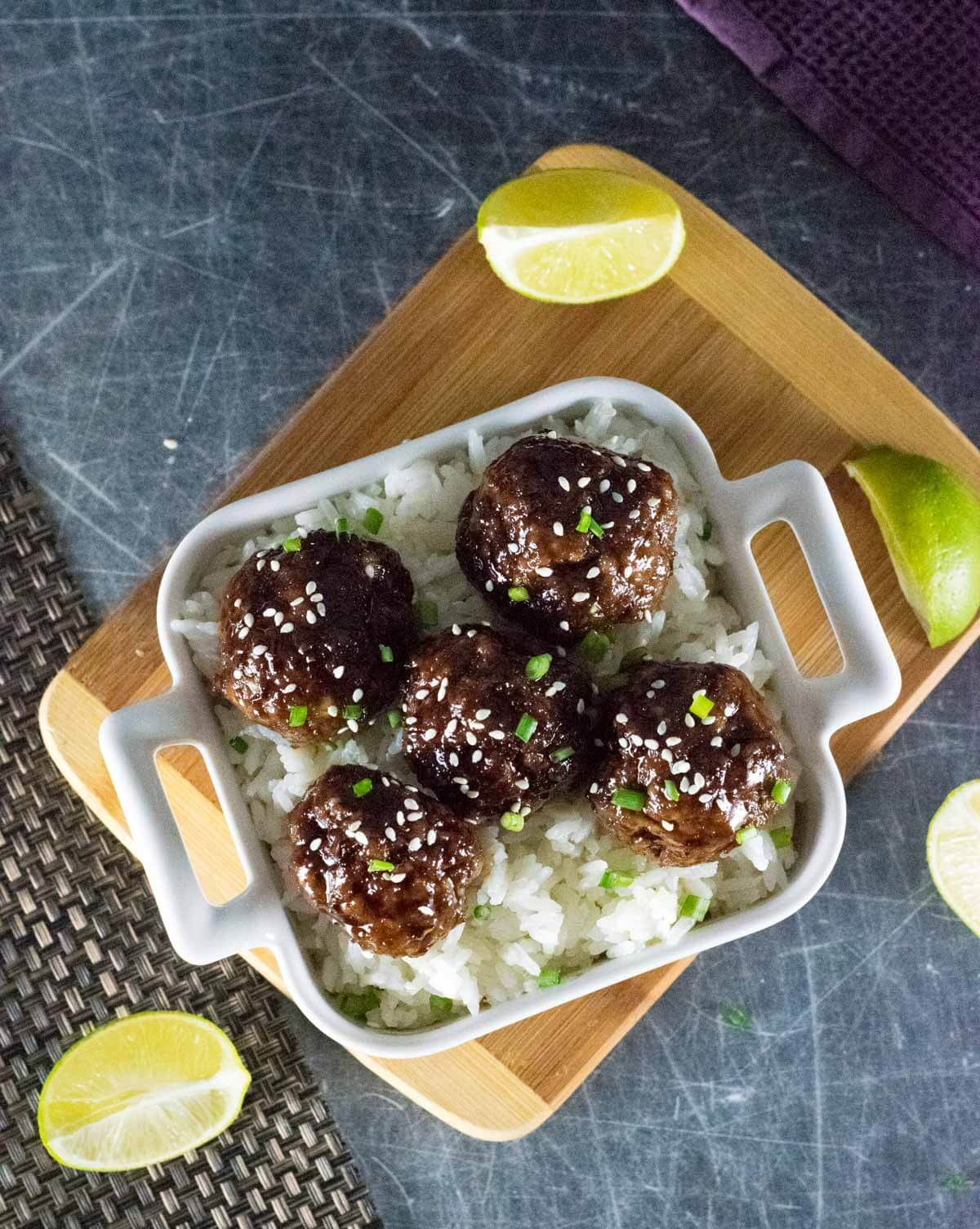 Mongolian Meatballs over rice with lime shown from above.