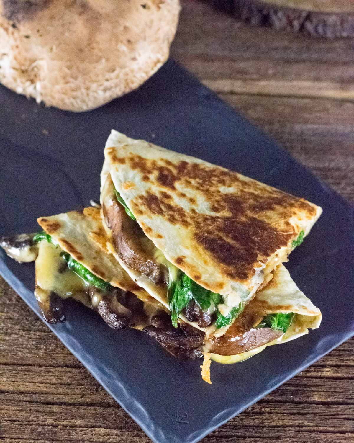 Vegetarian Mushroom Quesadillas stacked on each other.