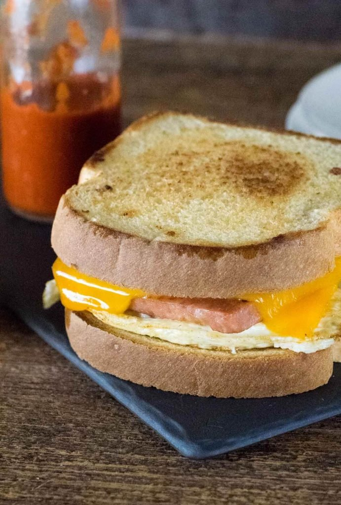 Spam and Egg Sandwich with hot sauce bottle