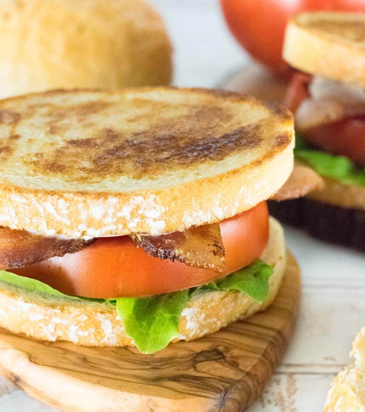 Ultimate BLT close up with thick cut bacon and ripe tomato.
