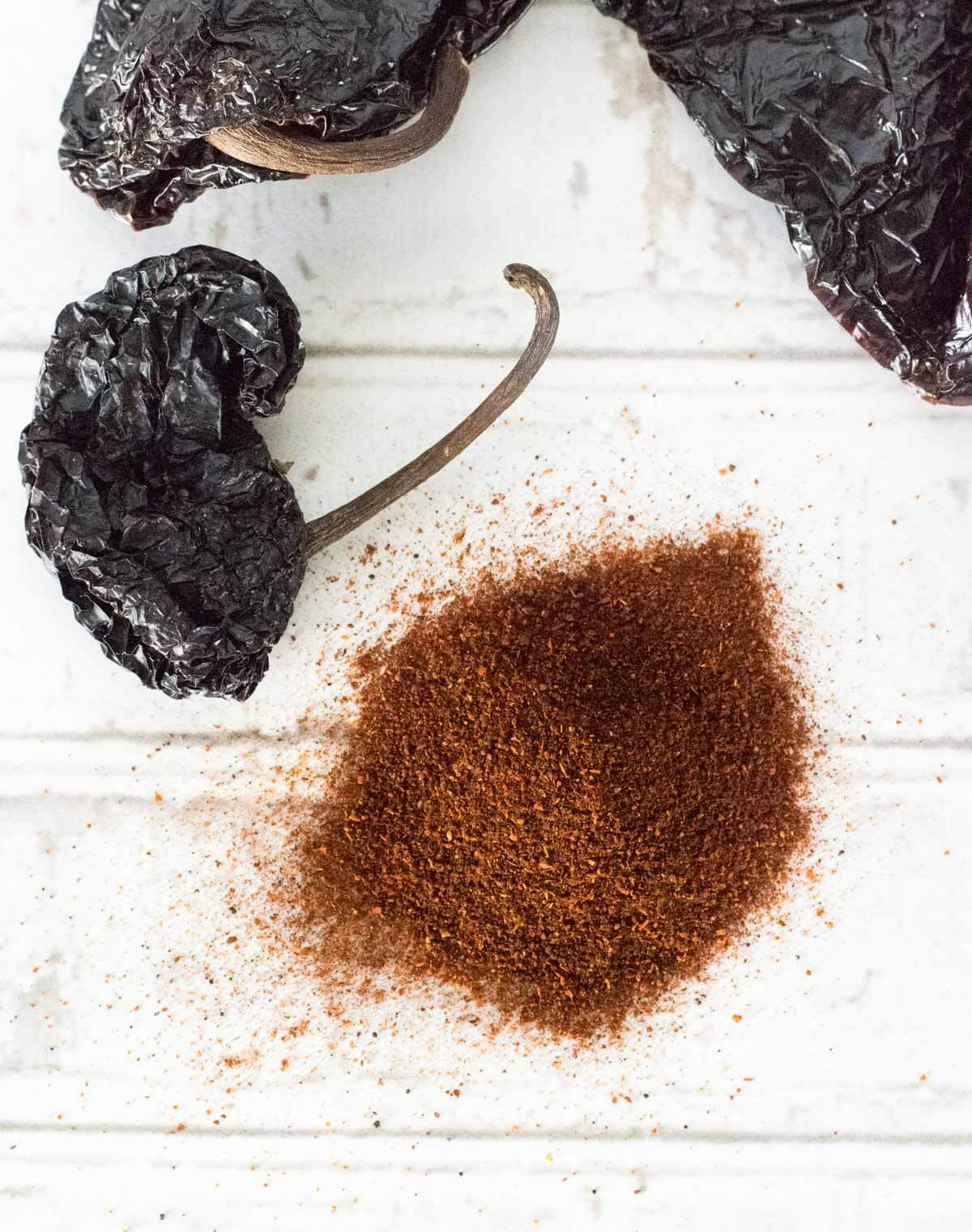 Ancho chili powder with dried peppers and seasoning