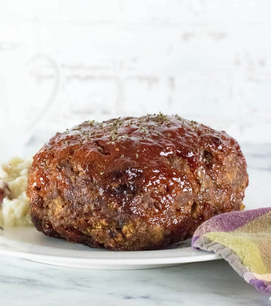 Cooked Bison Meatloaf that is not sliced.