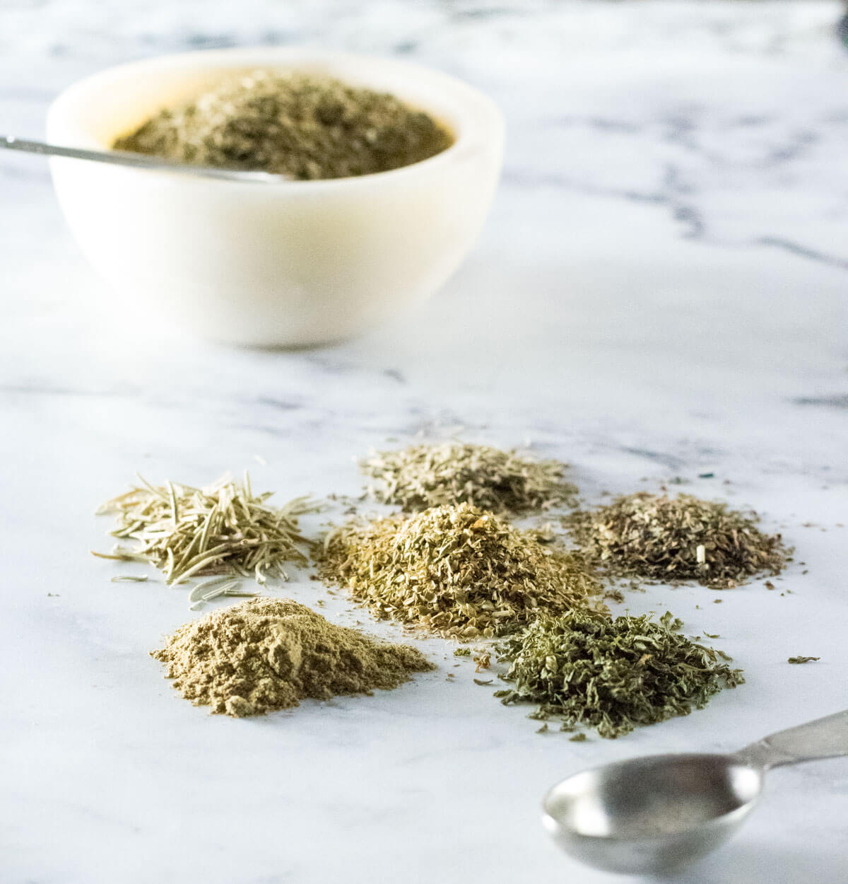 Italian seasoning separated into piles by each herb.