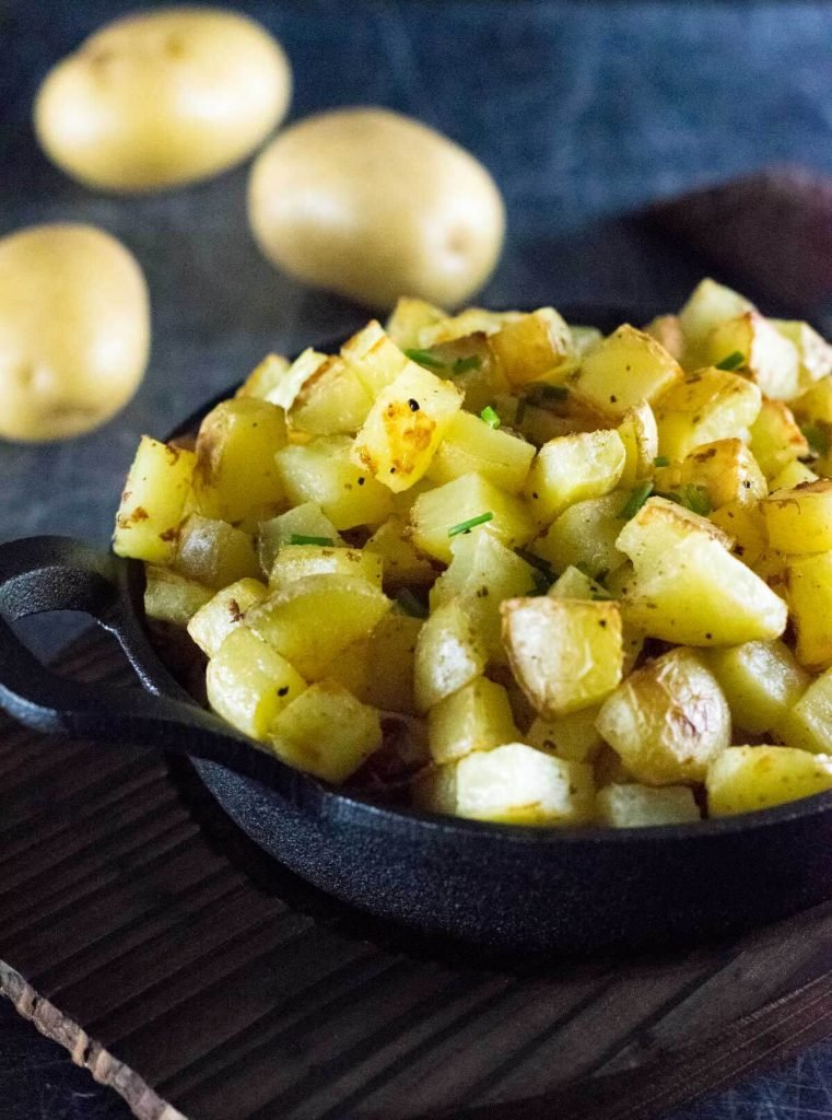 Roasted breakfast potatoes in pan, close up