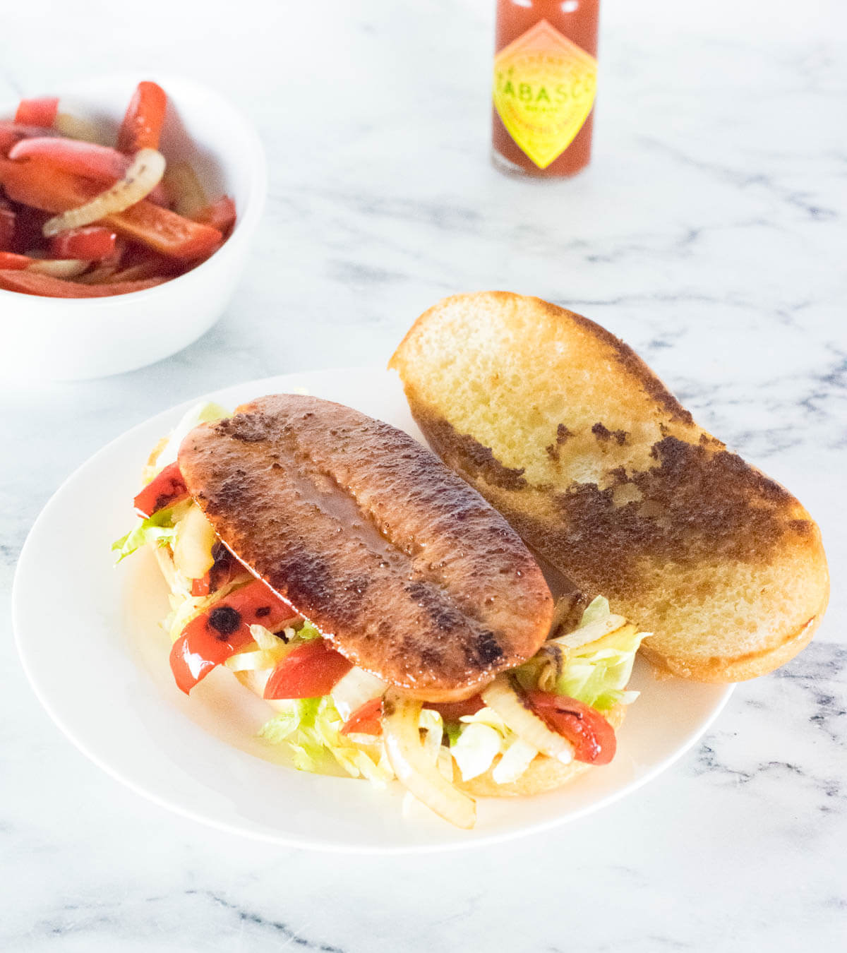 Split andouille sausage on hoagie roll