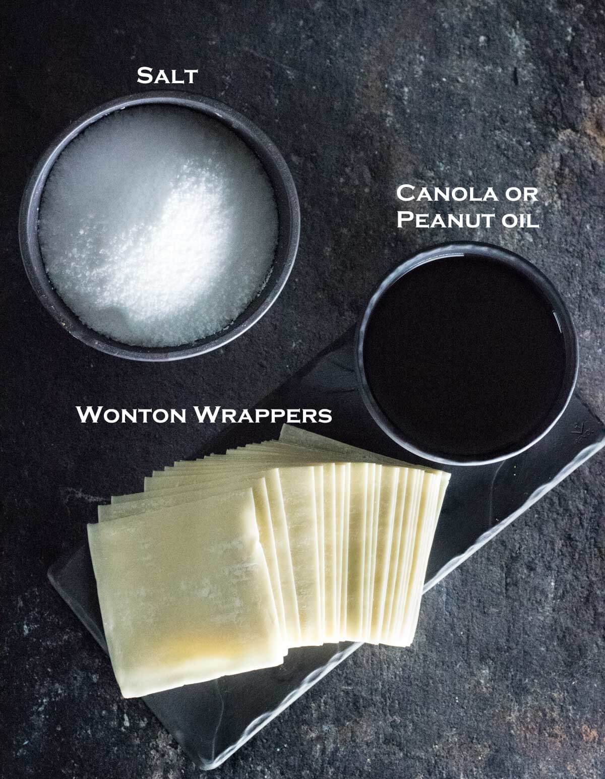 Wonton wrappers, frying oil, and salt in separate dishes.