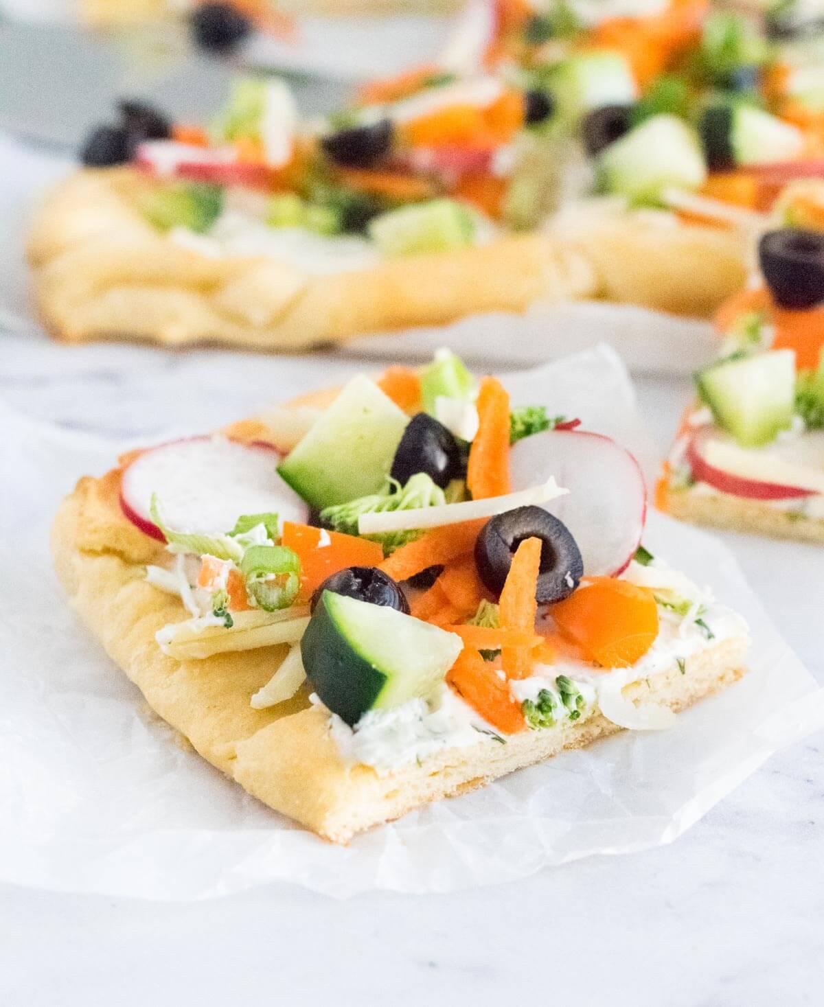 Crescent roll veggie pizza slice.
