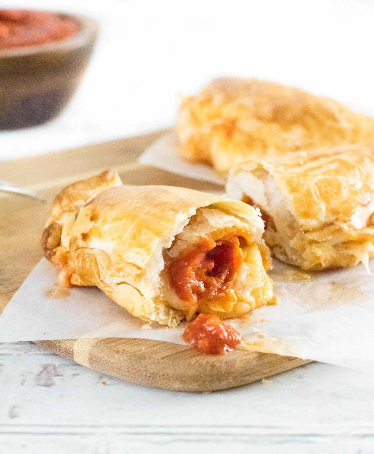 Pepperoni Pizza Hot Pocket cut open with sauce dripping out.