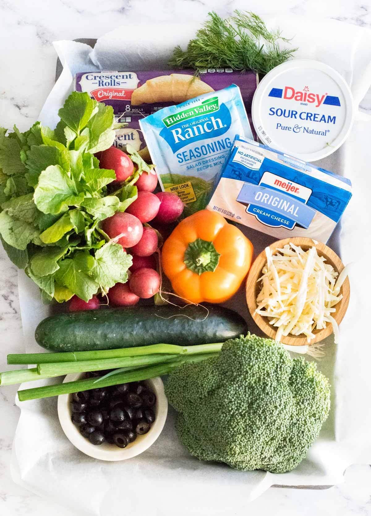 Fresh veggie pizza ingredients shown.