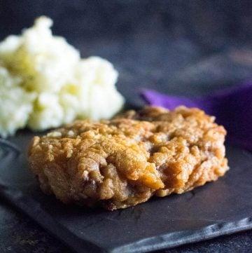 Fried venison cutlet shown close up.