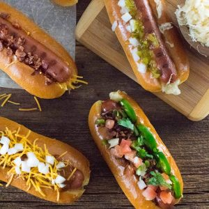 Loaded hot dogs being served.