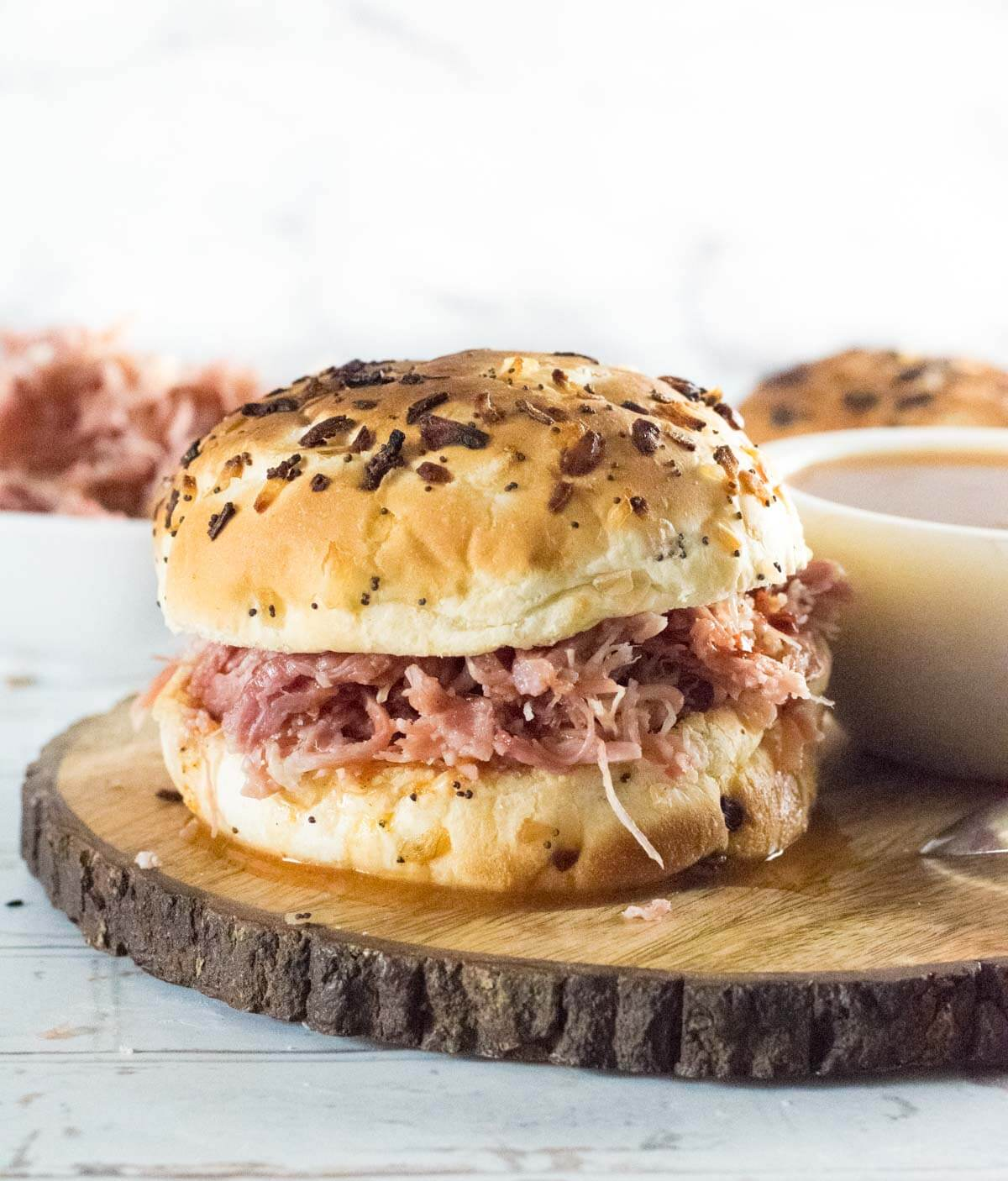 Pulled pork sandwich with finishing sauce.
