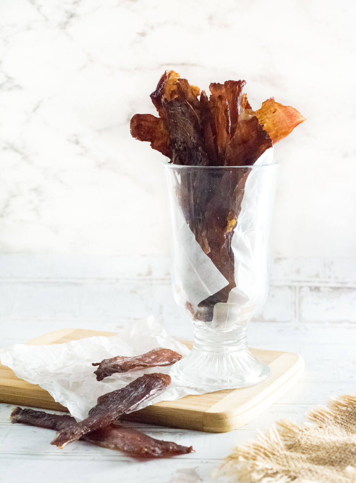 Sweet and spicy pork jerky served on table.