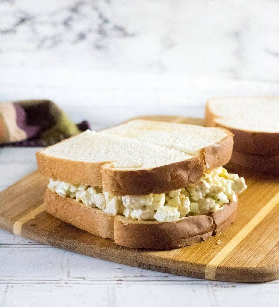 Chicken sandwich spread on white bread.