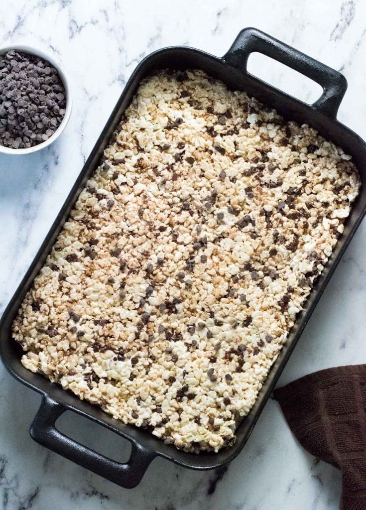 A pan of chocolate chip Rice Krispie treats, uncut.
