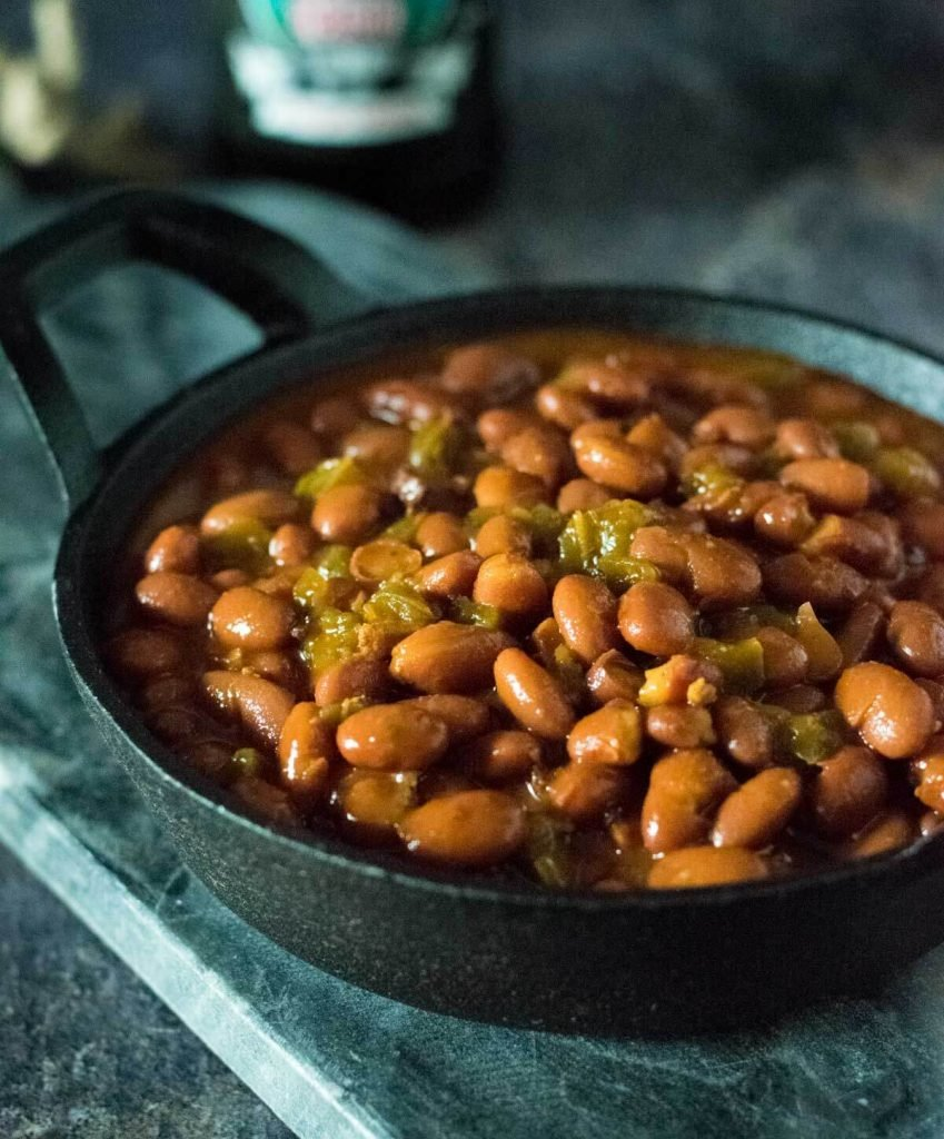 Close up view of smoked baked beans with bacon.