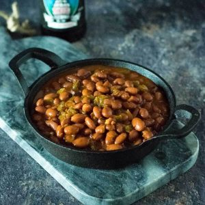Smoked baked beans on stone tray.