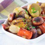 Smothered potatoes and sausage viewed close up.