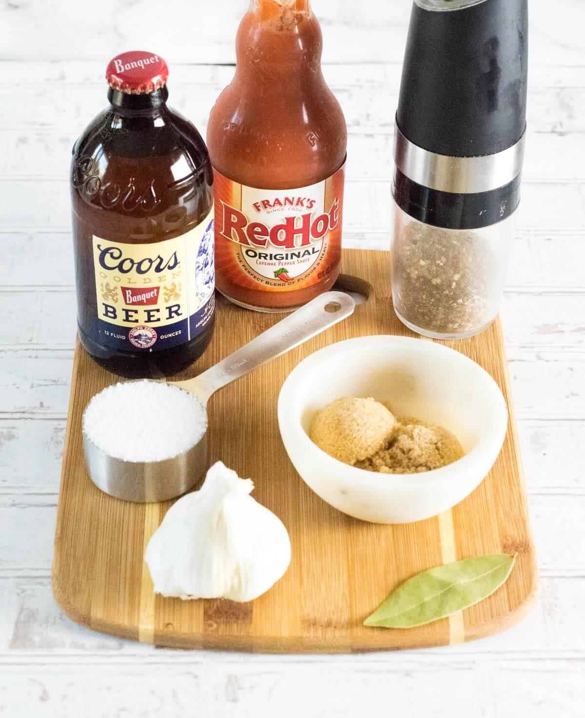 Chicken wings brine ingredients on board.