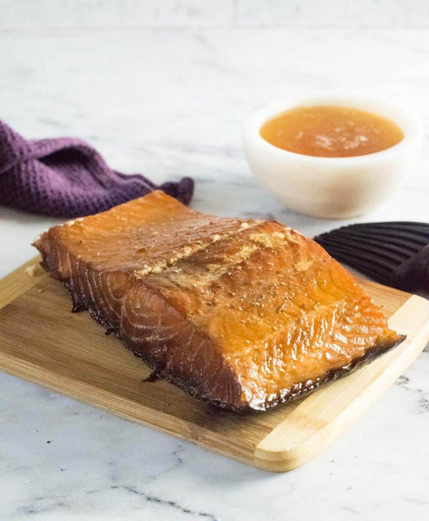Honey smoked salmon on plank.