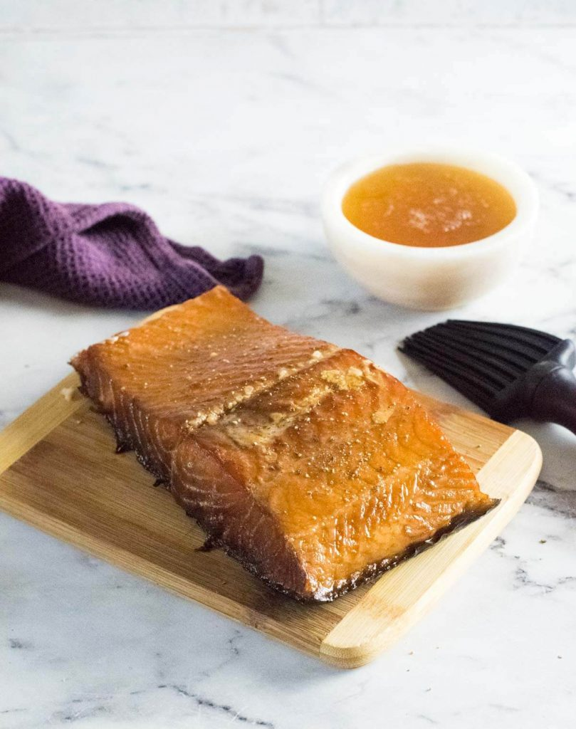 Smoked salmon with a bowl of honey.