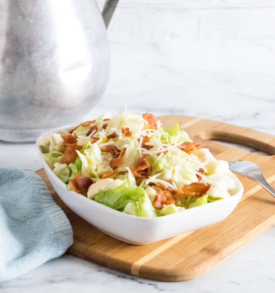 Tequilaberry's Salad on a cutting board in a white bowl.