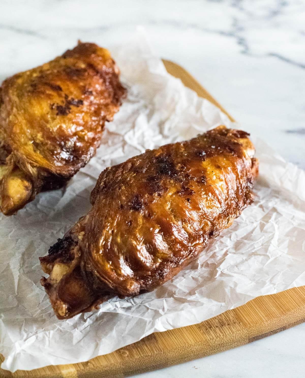 Deep fried turkey wings on wax paper.