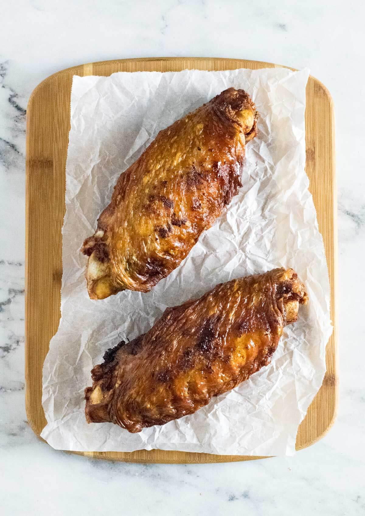 Deep fried turkey on cutting board.