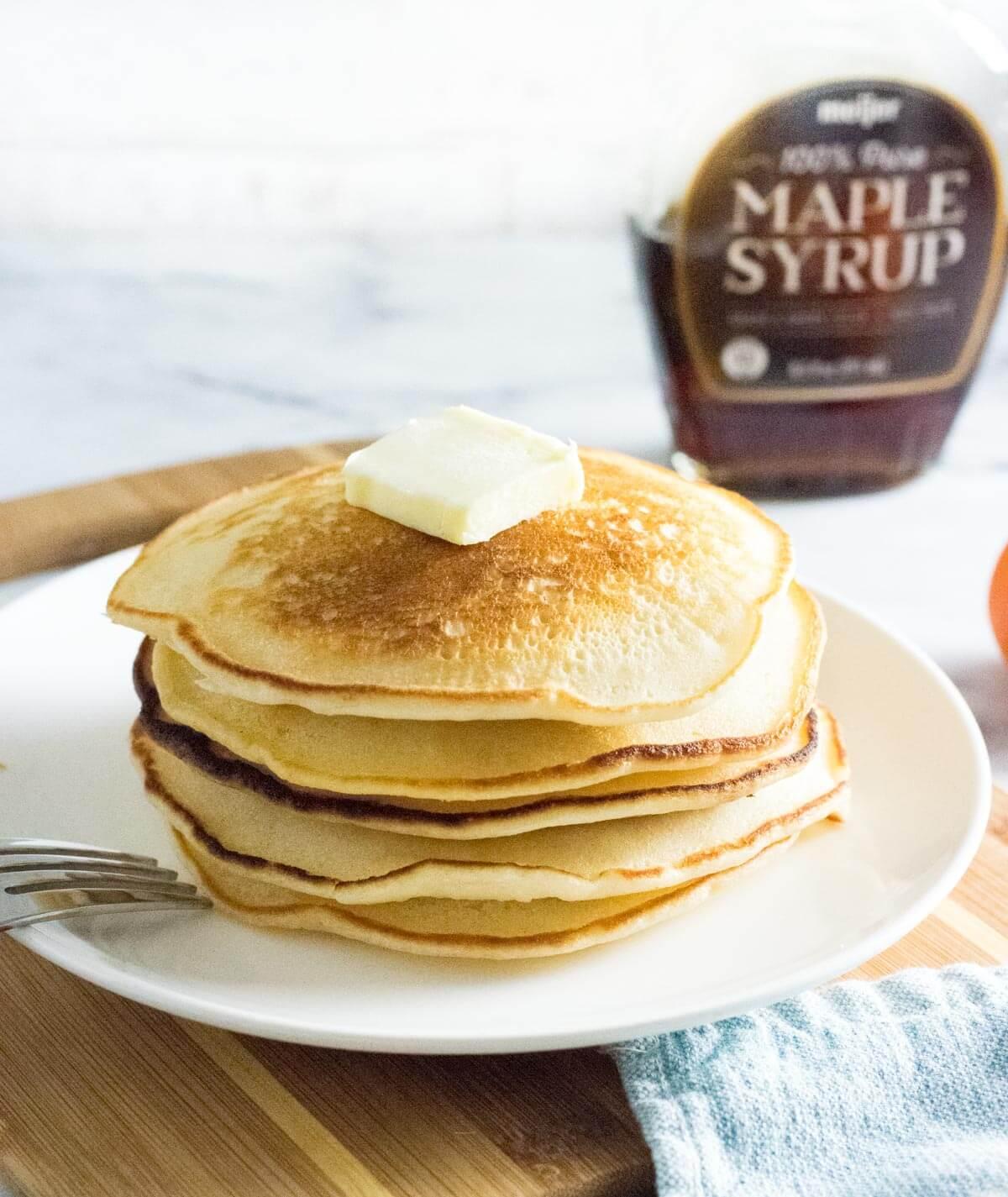 Eggless pancakes on white plate.