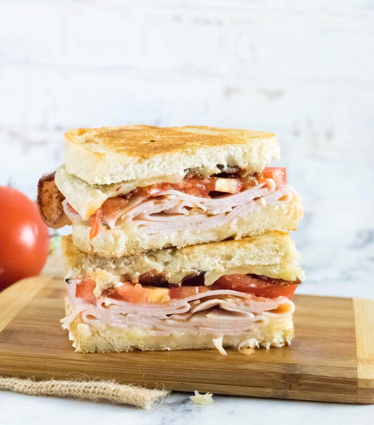 Sliced turkey melt sandwich.